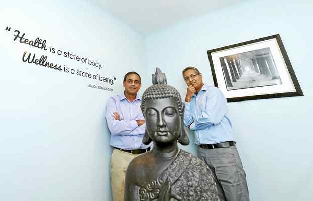 Tejal Desai, left, and Raj Patel, co-owners of the Southern CT Wellness & Healing, a medical marijuana dispensary, in their new Milford office on Tuesday. Peter Hvizdak — New Haven Register